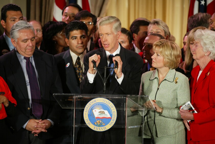 Then Gov. Gray Davis at lectern with crowd of supporters