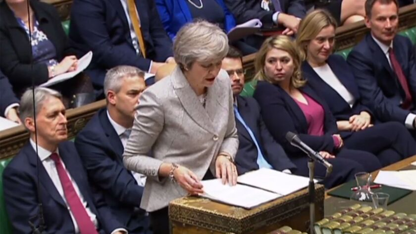 British Prime Minister Theresa May speaks to the House of Commons about a draft declaration laying out plans for future relations with the European Union.