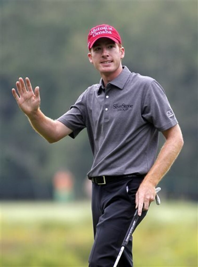 Roberto Castro acknowledges the crowd after making a birdie putt on the third hole during the second round of the Deutsche Bank Championship golf tournament in Norton, Mass., Saturday, Aug. 31, 2013. (AP Photo/Stew Milne)