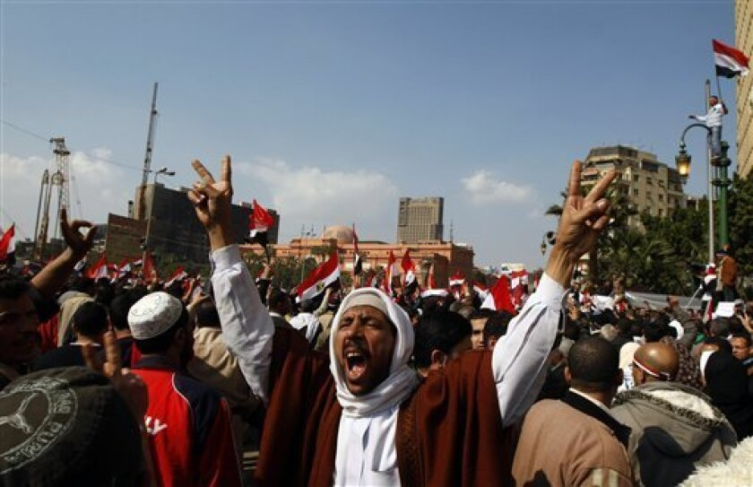 An nti-government protester chant slogans during the continuing demonstration in Tahrir Square, in downtown Cairo, Egypt,  Friday, Feb. 11, 2011. (AP Photo/Khalil Hamra)