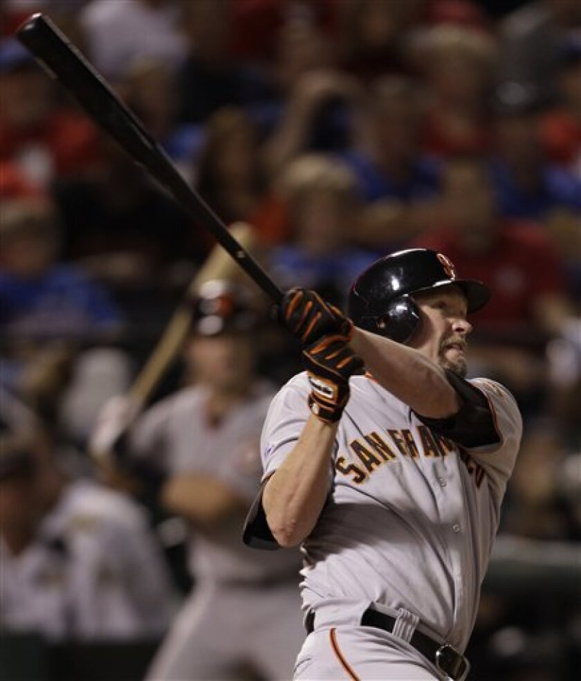 San Francisco Giants' Aubrey Huff watches his two run home run during the third inning of Game 4 of baseball's World Series against the Texas Rangers Sunday, Oct. 31, 2010, in Arlington, Texas. (AP Photo/David J. Phillip)