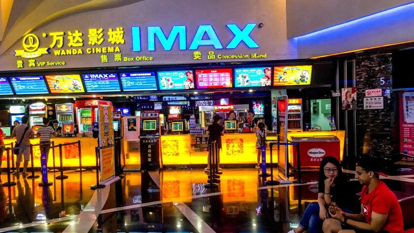 Customers buy movie tickets in a Wanda IMAX cinema in China.