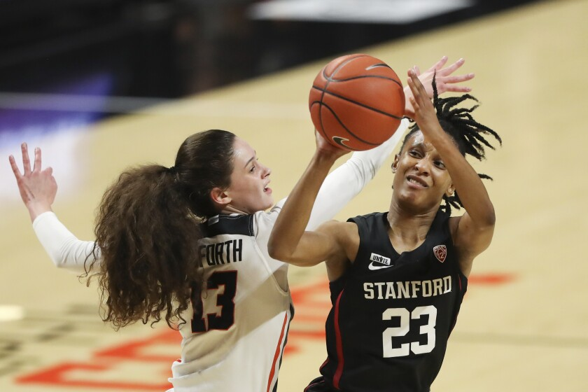 FILE - Stanford's Kiana Williams (23) avoids a block by Oregon State's Sasha Goforth (13) during the first half of an NCAA college basketball game in Corvallis, Ore., in this Saturday, Feb. 13, 2021, file photo. No. 4 Stanford remains the class of the conference as it enters a Pac-12 women's tournament loaded with strong teams at the top, including No. 9 UCLA and No. 11 Arizona. (AP Photo/Amanda Loman, File)