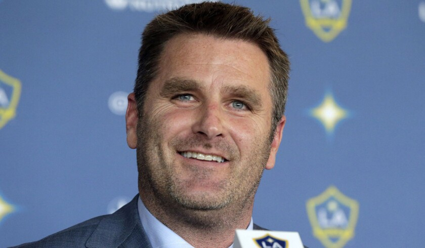 Curt Onalfo smiles as he is introduced as coach of the Galaxy at a news conference in Carson.
