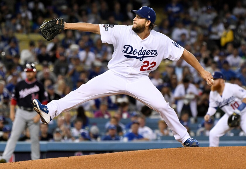 Dodgers pitcher Clayton Kershaw throws a pitch against the Washington Nationals in the first inning in Game 2 of the NLDS at Dodger Stadium on Oct. 4.