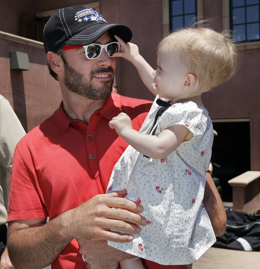 Jimmie Johnson plays with daughter Genevieve at the Jimmie Johnson Foundation Golf Tournament at The Grand Del Mar