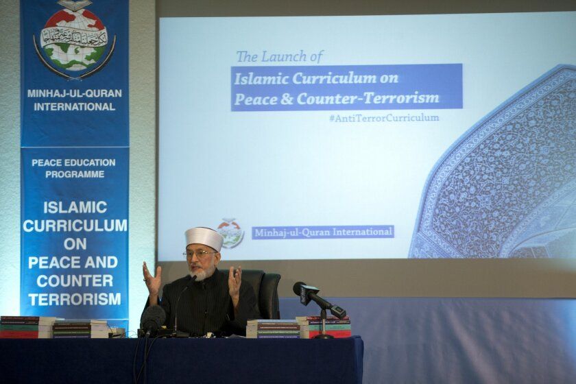 Pakistan cleric Shaykh-ul-islam Dr Muhammad Tahir-ul-Qadri, the founder of the Minhaj-ul-Quran International organization, delivers a keynote speech at the launch of the Islamic Curriculum on Peace and Counter Terrorism in London, Tuesday, June 23, 2015. The curriculum is described by the organizer