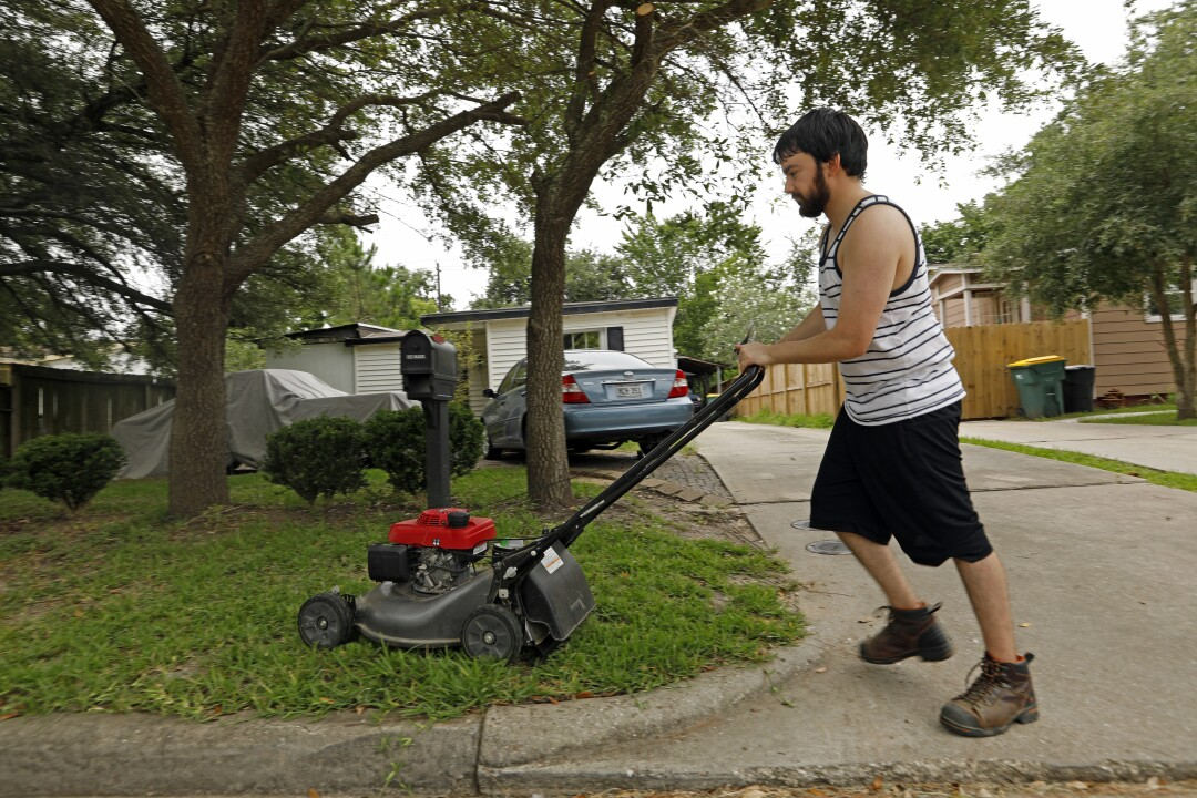 Daniel Herrera, 26, was mowing his own lawn this week after losing contract jobs as an electrician's helper at nearby plants.