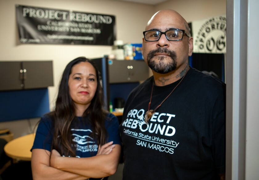 Project Rebound has been established at Cal State San Marcos to assist students who are transitioning out of the prison system. The program is coordinated by CSUSM professor Martin Levya, right. Rachael Jarrell, left, is a member of the program, which operates from a small office in the university's library.