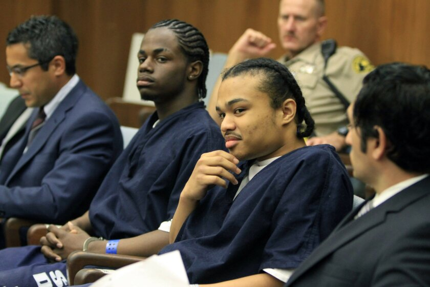 Defendants Rashon Abernathy, center right, and Shaquille Jordan , center left, before their sentencing in San Diego Superior Court in the killing of an 18-year-old college student who was responding to a Craigslist ad.