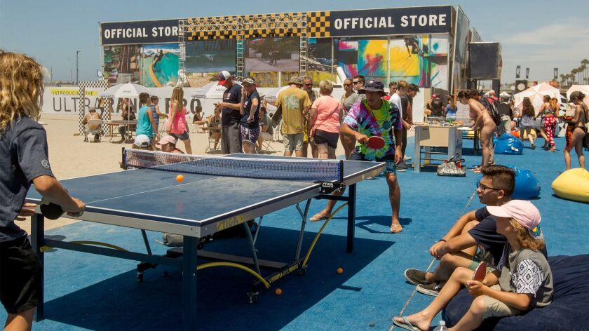 Visitors play table tennis Thursday during the U.S. Open of Surfing.