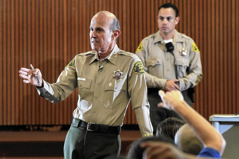Three deputies accused of hindering a federal investigation state in court filings that former L.A. County Sheriff Lee Baca, pictured, and his then-aide, Paul Tanaka, directed the handling of a jail inmate working as an FBI informant.