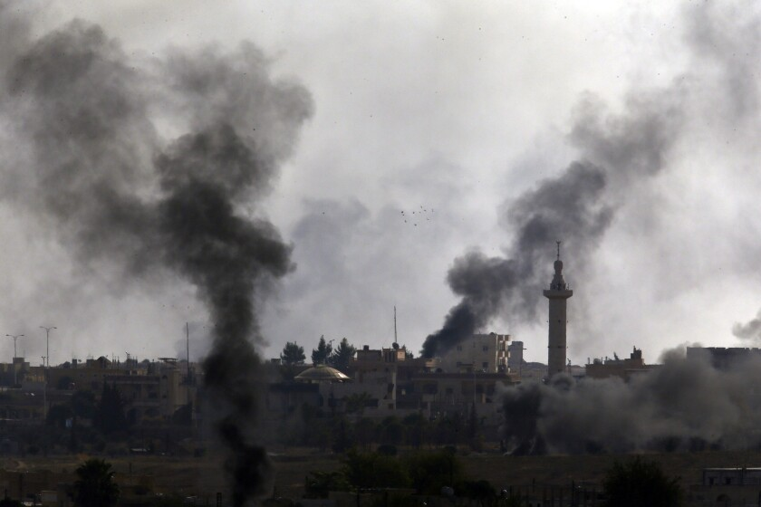 Smoke billows from targets in Syria during bombardment by Turkish forces