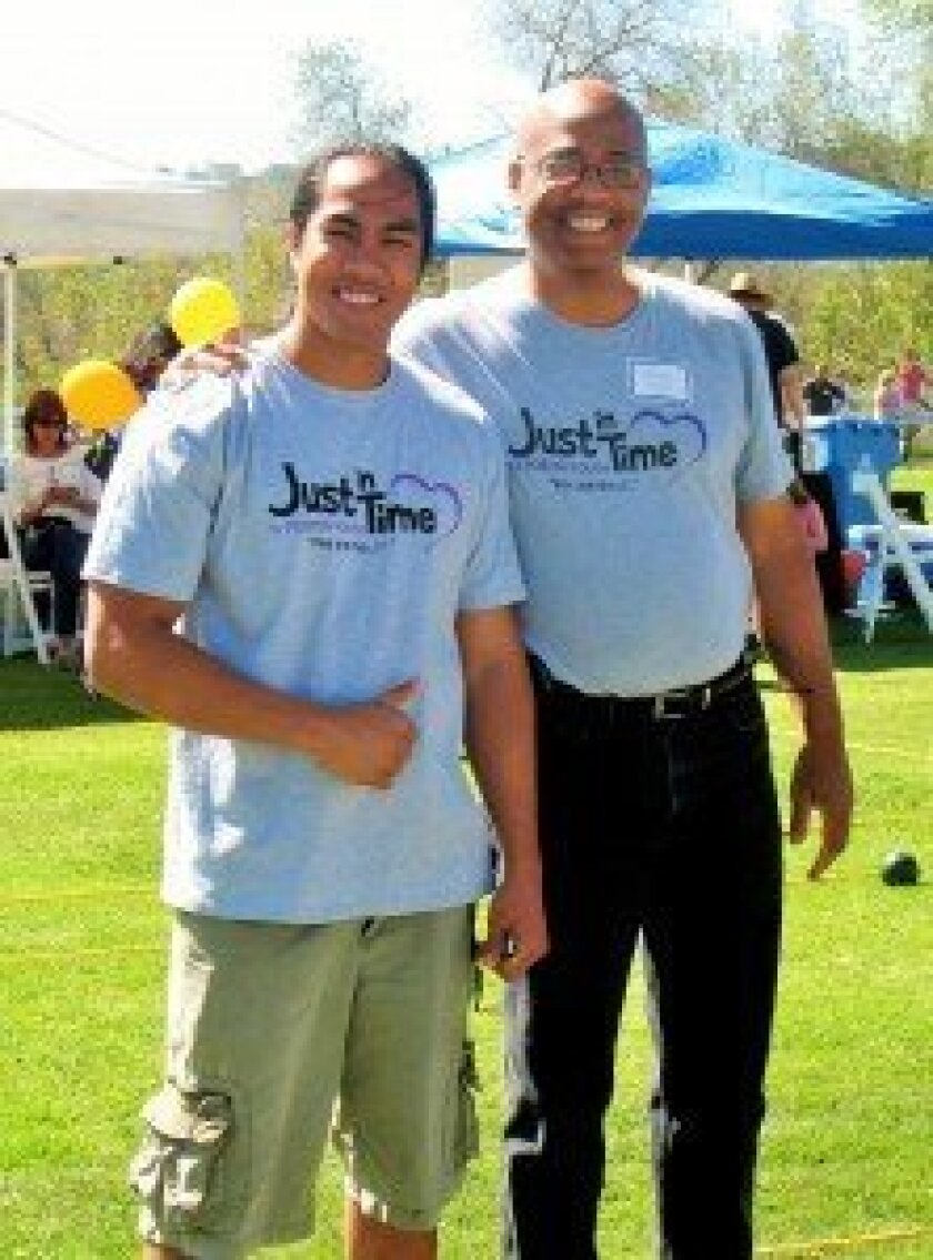 Representing Just In Time for Foster Youth at Del Mar-Solana Beach Rotary Club's Turf Bocce Tournament are Max Ellorin, IT and tracking specialist (left), and Don Wells, executive director (right).