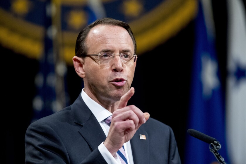 FILE - In this May 9, 2019, file photo, then-Deputy Attorney General Rod Rosenstein speaks during a farewell ceremony in the Great Hall at the Department of Justice in Washington. Senate Republicans are planning to press Rosenstein on his oversight of the Russia investigation in the first in a series of oversight hearings that coincides with accelerated election-year efforts to scrutinize the FBI probe. (AP Photo/Andrew Harnik, File)