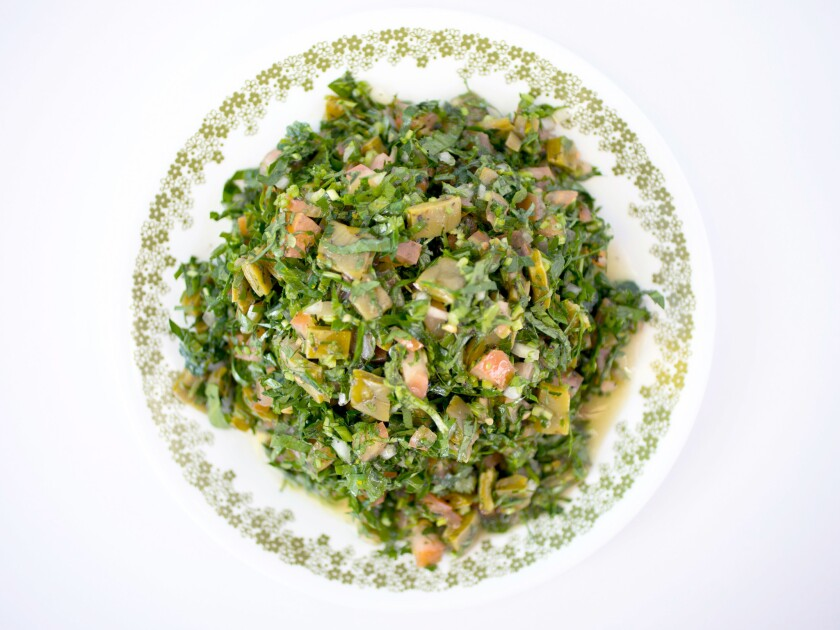 Tabbouleh Oaxaca salad with tomatoes, cilantro, onions and citrus.