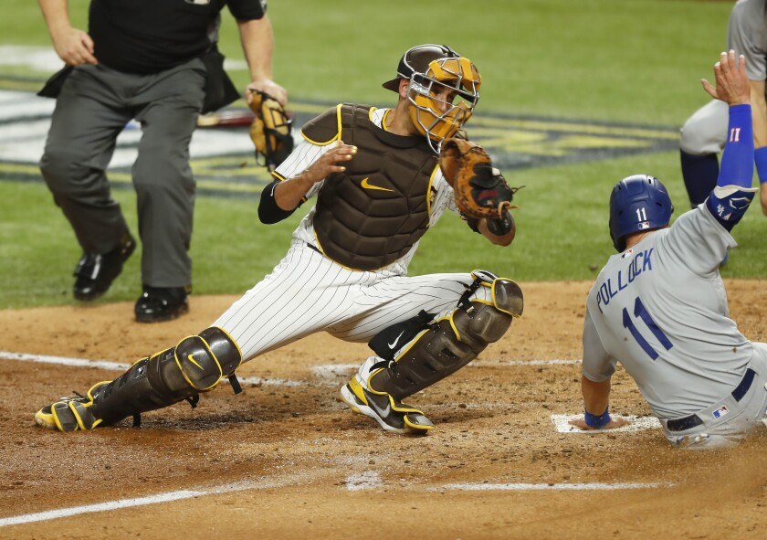 The Padres' Jason Castro tries to tag out The Dodgers' AJ Pollock