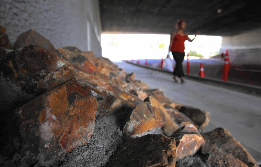 Riprap next to the walls of a 5 Freeway overpass in San Diego was installed last week at the request of nearby residents.