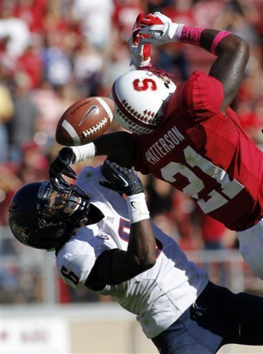 Arizona's Jonathan McKnight, left, defends against a pass intended for Stanford's Drew Madhu (21) during the second half of an NCAA college football game in Stanford, Calif., Saturday, Oct. 6, 2012. (AP Photo/George Nikitin)