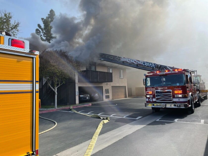 Santee firefighters attack a fire at a condominium complex on Carefree Drive on Saturday.