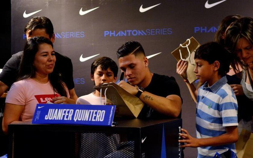 Colombian midfielder Juan Fernando Quintero signs autographs at an event in Medellin, Colombia, on Friday, Dec. 28. EFE-EPA/Leon Monsalve
