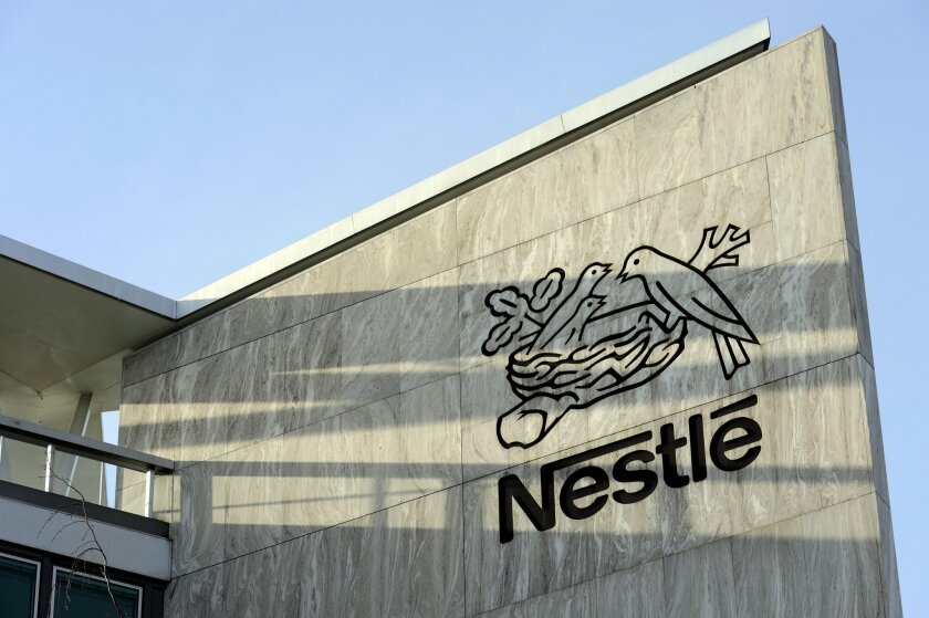 FILE - In this Feb. 14, 2013 file picture the Nestle logo is  photographed  at the Nestle headquarter  in Vevey, Switzerland. Food and beverage giant Nestle told the IAAF on Wednesday, Feb. 10, 2016 that it terminated its sponsorship of athletics' governing body over fears the doping scandal could