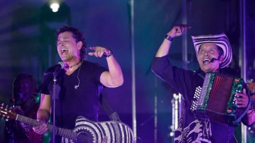 Carlos Vives (left) is shown performing last month with accordionist Ejidio Cuadrado in Ciudad, México, Vives is part of all-star lineup at Saturday's RiseUp AS ONE concert at U.S./Mexico border.