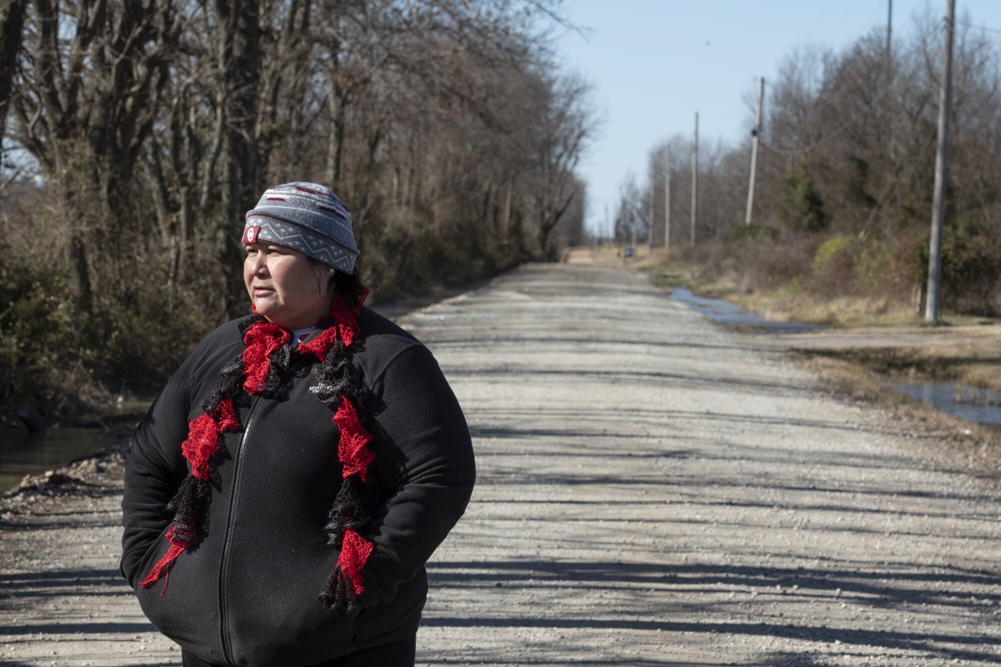 Pam Smith on a dirt road near the area where her niece, Aubrey Dameron, was last seen in March.