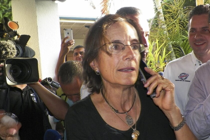 Salud Hernandez-Mora, correspondent in Colombia for Spain's El Mundo and columnist for the Bogota daily El Tiempo, speaks on the phone after being freed by leftist rebels in Ocana, northeastern Colombia, Friday, May 27, 2016. Hernandez-Mora said she was taken captive on May 21 by rebels of the Nati