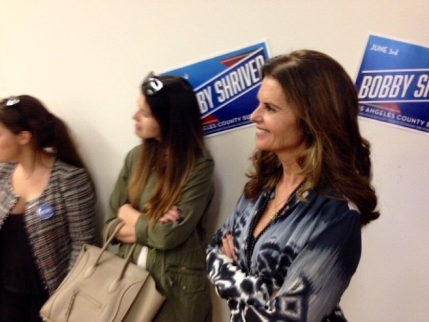 Maria Shriver watches her older brother, Bobby Shriver, address supporters at a campaign event in Santa Monica.