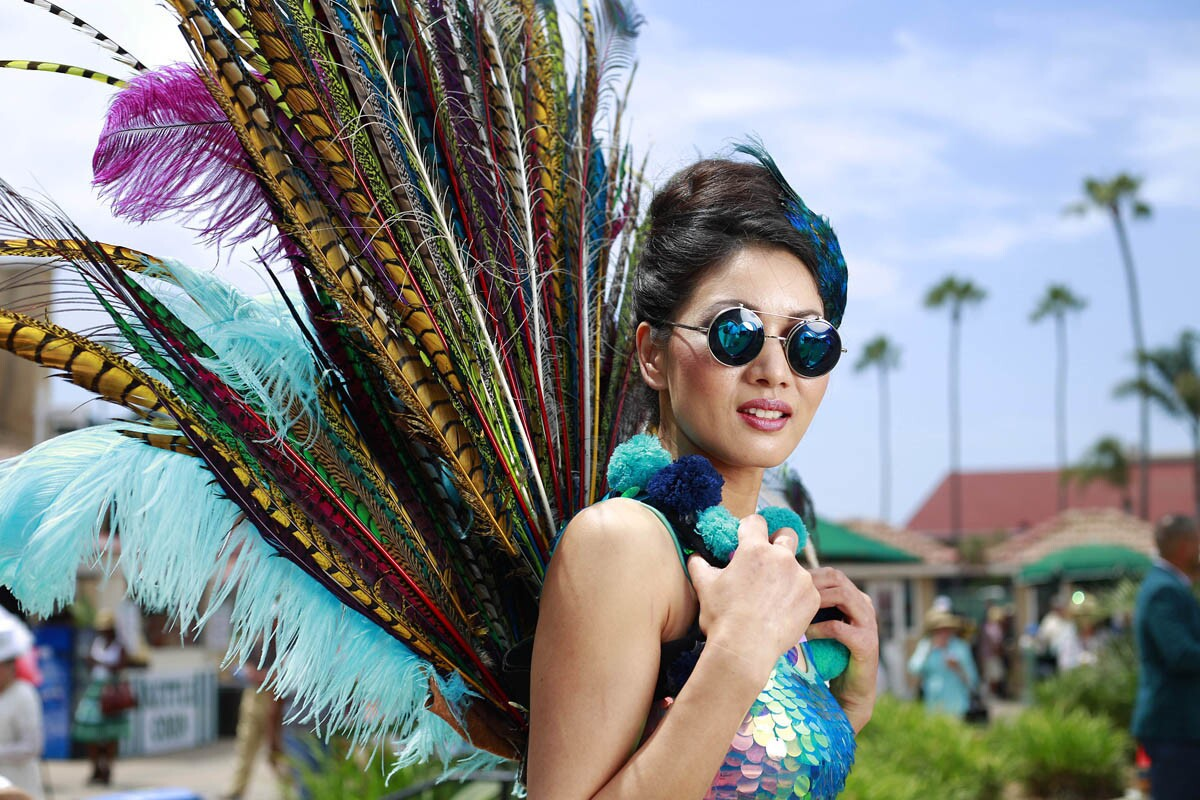 Gigi Ziang shows off her hat on Opening Day at the Del Mar Thoroughbred Club on July 19, 2017. (Photo by K.C. Alfred/The San Diego Union-Tribune)