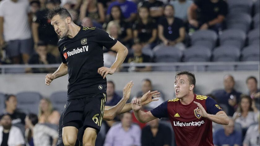 LAFC's Danilo Silva, left, heads the ball next to Real Salt Lake's Corey Baird during a game last season.
