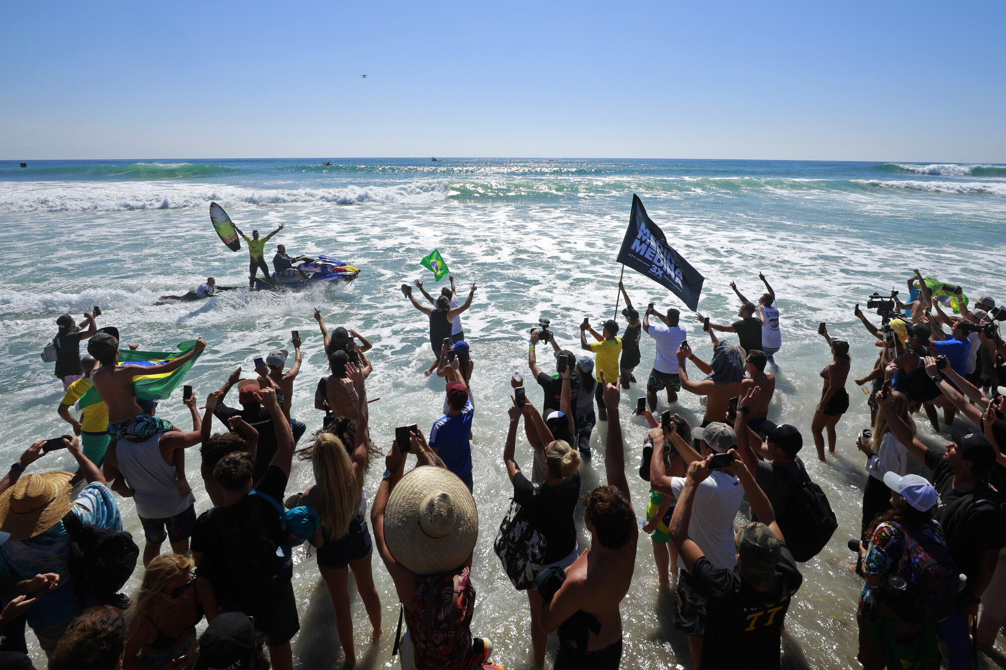 SAN DIEGO, CA - SEPTEMBER 14: Gabriel Medina of Brazil celebrates with fans after he won the world championship