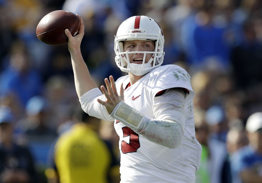 FILE - In this Saturday, Nov. 24, 2018 file photo, Stanford quarterback K.J. Costello throws against UCLA during the first half of an NCAA college football game in Pasadena, Calif. Former Stanford quarterback K.J. Costello says he plans to finish his college career playing for Mike Leach at Mississippi State. Costello announced his decision via social media on Monday, Feb. 3, 2020 less than a month after Mississippi State hired Leach away from Washington State.(AP Photo/Marcio Jose Sanchez, File)