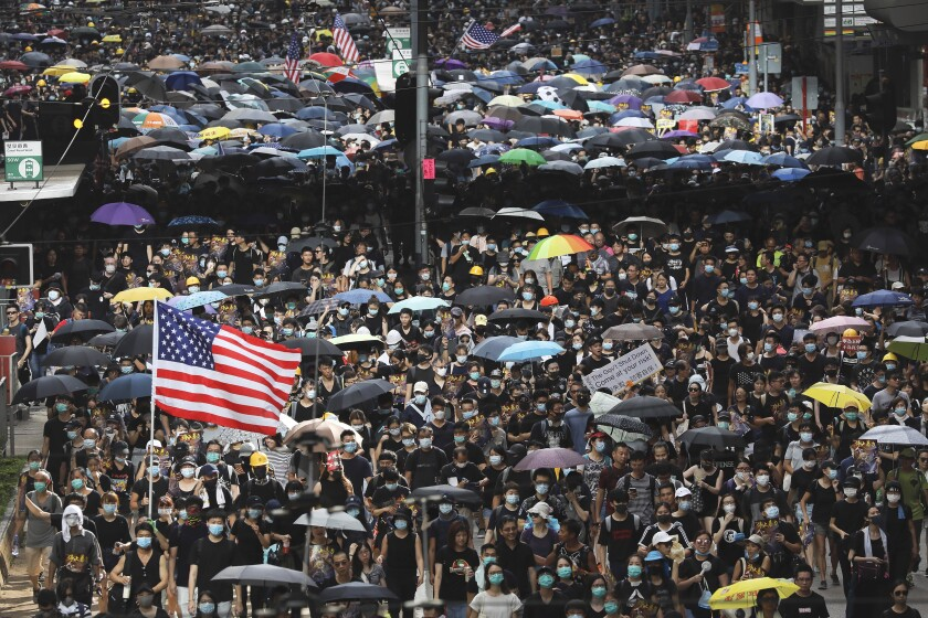 Protesters carry U.S. flags during the anti-Chinese government demonstrations in Hong Kong.