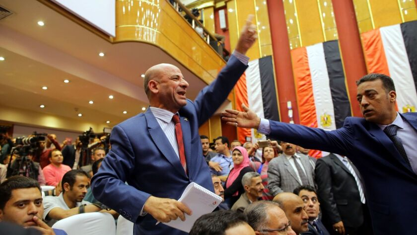 A man reacts during a National Election Commission news conference in Cairo on Monday at which the final results of Egypt's presidential election were announced.