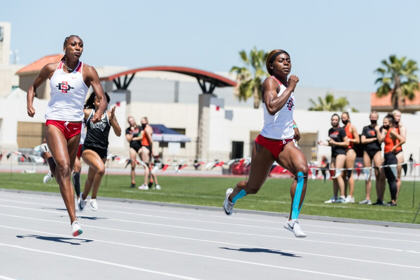 Jada Moore (right) of San Diego State won three golds at Mountain West championships.