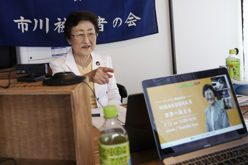 "Michiko Kodama, assistant secretary-general of the Japan Confederation of A and H Bomb Sufferers' Organizations, prepares to narrate her experience on a livestream of ""Kataribe"" or story-telling session Sunday, July 12, 2020, in Tokyo. ""For me, the war is not over yet,"" said Michiko Kodama, 82, who survived the bombing but has lost most of her relatives from cancer, including one of her two daughters. Years after the atomic bombing, a receptionist at a clinic near Tokyo noted Kodama's ""hibakusha"" medical certificate in a loud voice, and a patient sitting next to her in a waiting room moved away from her. The fear of death, prejudice and discrimination at work and in marriage continues, and nuclear weapons still exist. (AP Photo/Eugene Hoshiko)"