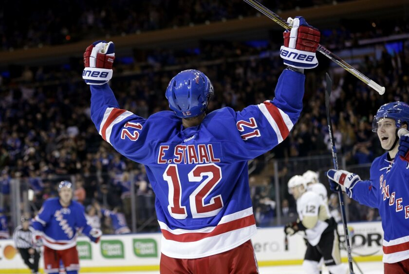 FILE - In this March 27, 2016, file photo, New York Rangers' Eric Staal reacts after scoring his second goal during the second period of an NHL hockey game against the Pittsburgh Penguins, in New York. Eric Staal has made the mundane commute hundreds of times over the years from his home in Raleigh to the Carolina Hurricanes' rink. But it will be different Thursday night. When he walks into the arena, he'll make a left into the visitors' dressing room. (AP Photo/Seth Wenig, File)