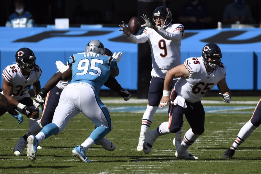 Chicago Bears quarterback Nick Foles (9) reaches for the ball during the first half of an NFL football game against the Carolina Panthers in Charlotte, N.C., Sunday, Oct. 18, 2020. (AP Photo/Mike McCarn)