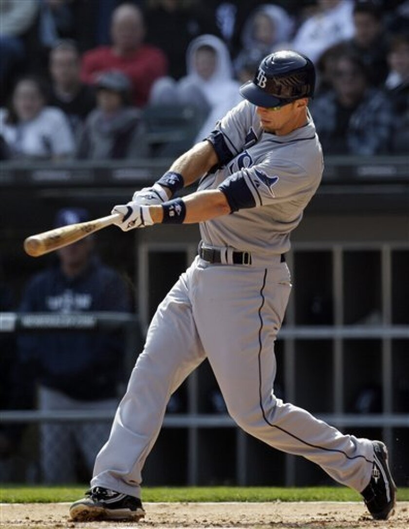 Tampa Bay Rays' Ben Zobrist hits an RBI double against the Chicago White Sox during the second inning of a baseball game in Chicago, Saturday, April 9, 2011. (AP Photo/Nam Y. Huh)