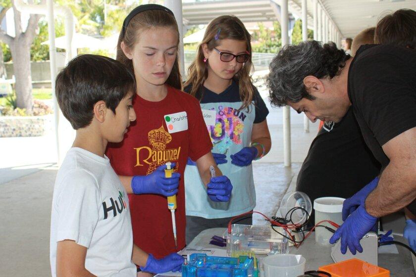 Ryan Jelveh, Charlotte Gayner and Jaden Frederick experiment with medical equipment.