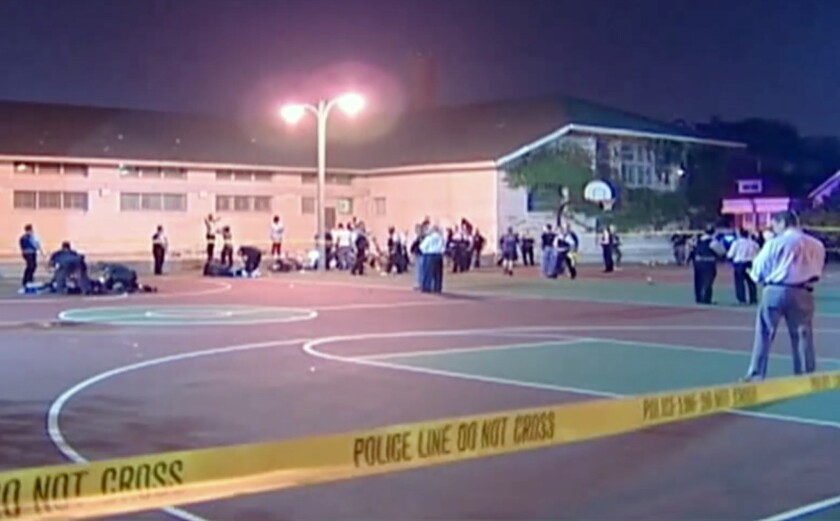 A still frame from a video shows the scene where a number of people, including a 3-year-old child, were shot in a city park in Chicago.