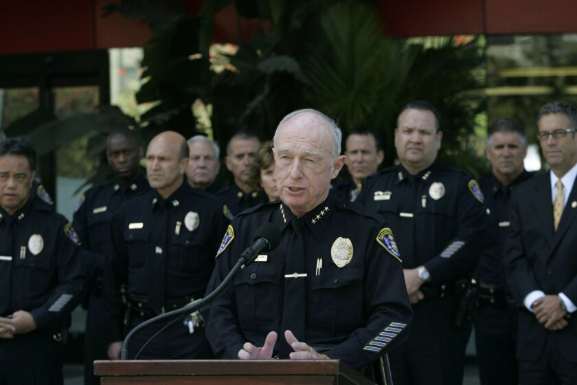 Surrounded by his command staff, San Diego Police Chief William Lansdowne outlined his department's plan for dealing with a recent rash of officer misconduct cases.