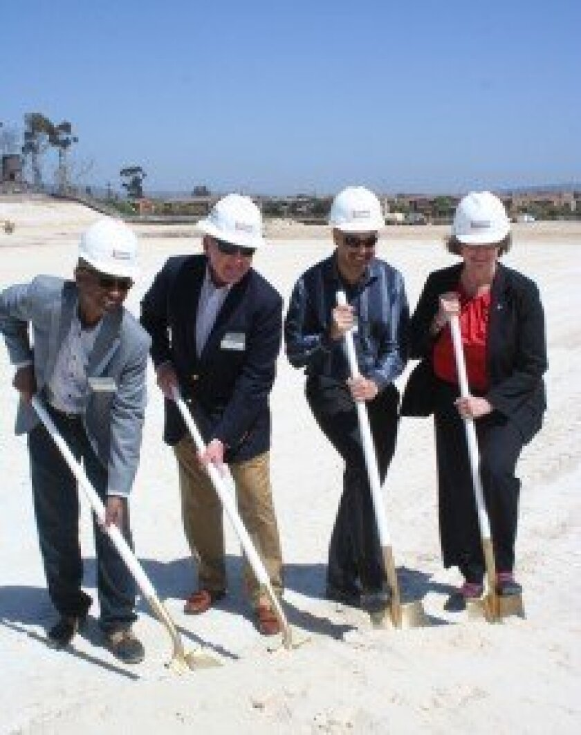 The groundbreaking for the Village at Pacific Highlands Ranch was held on April 16 with ceremonial digs by Carmel Valley Community Planning Board Chair Frisco White; Tom Blake, founder and president of Coast Income Properties; Carmel Valley Community Planning Board Vice Chair Manjeet Ranu; and San Diego Councilmember Sherri Lightner. Photo by Karen Billing