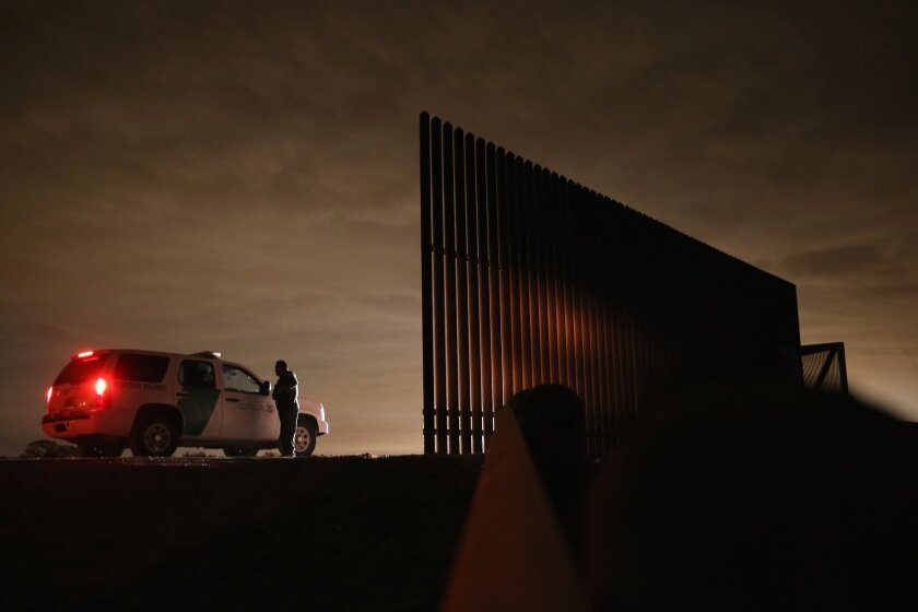 Border Patrol agents near a section of U.S.-Mexico border fence in La Joya, Texas. This week, the union representing agents complained of poor leadership by agency officials.