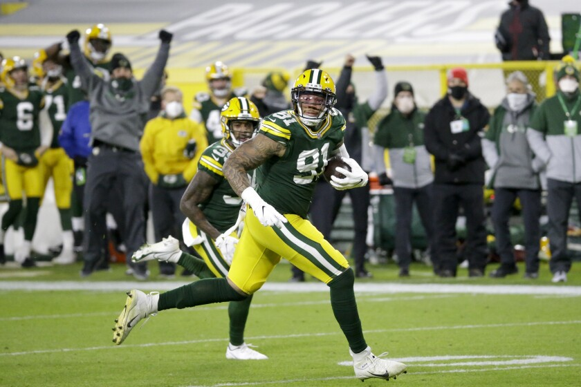 Green Bay Packers' Preston Smith runs for a touchdown on a fumble recovery during the first half of an NFL football game against the Chicago Bears Sunday, Nov. 29, 2020, in Green Bay, Wis. (AP Photo/Mike Roemer)