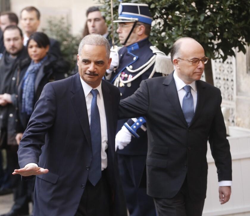 U.S. Atty. Gen. Eric Holder, left, and French Interior Minister Bernard Cazeneuve in Paris on Sunday before an international meeting on terrorism.