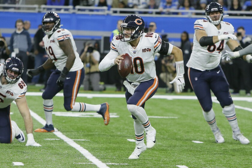 Bears quarterback Mitch Trubisky scrambles during the second half of the game against the Lions on Nov. 28, 2019, in Detroit.