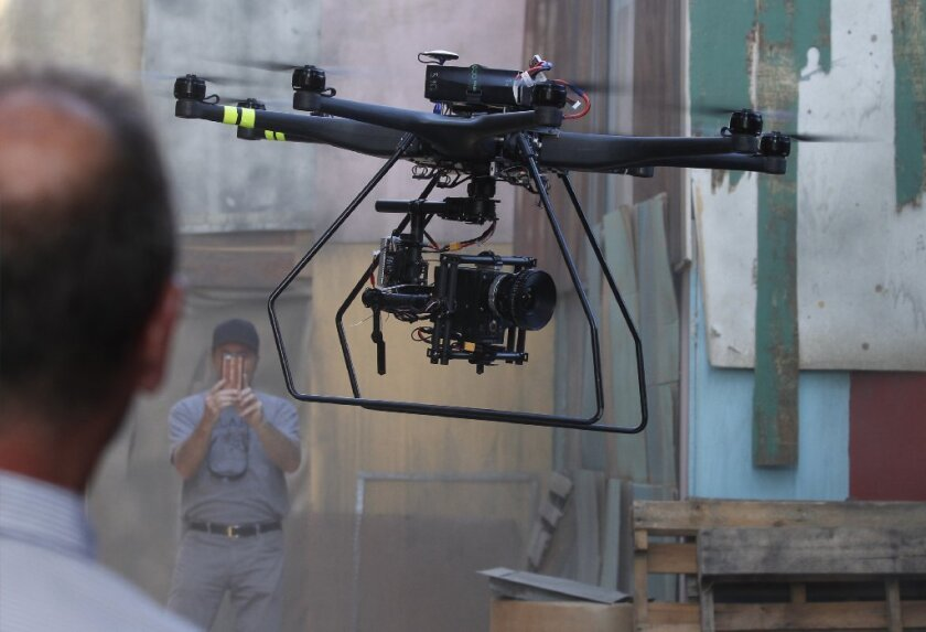 "A drone lands after filming a scene on the set of ""Criminal Minds: Beyond Borders"" in Santa Clarita. On Wednesday, Los Angeles City Atty. Mike Feuer filed the first criminal charges against civilian drone operators under a new ordinance passed last year."